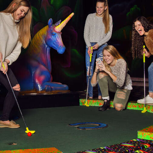 millenial girls playing glow golf fleetway